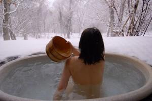 woman enjoying Japanese hot spring, onsen