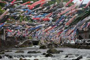 Koinobori Canopy over river near Tsuetate Onsen, Kumamoto, Kyushu during Golden Week in japan